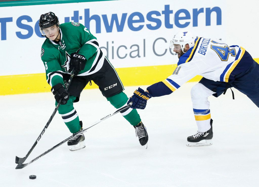 Dallas Stars defenseman Julius Honka (6) and St. Louis Blues defenseman Robert Bortuzzo (41) battle for the puck during the second period of an NHL preseason hockey game, Monday, Sept. 26, 2016, in Dallas.  (AP Photo/Jim Cowsert)