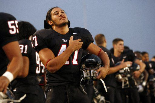 "Euless Trinity linebacker Elikena ""Eric"" Fieilo (47) stands during the National Anthem comes to a close before a game against Keller at Pennington Field on September 26, 2008."