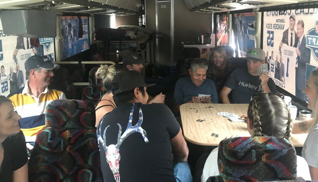 Family and friends of Leighton Vander Esch pass the time playing cards on their trip from Riggins, Idaho, to Seattle to watch the Cowboys rookie play. The group piled into the Vander Esch Express, the family's bus, for the trip.
