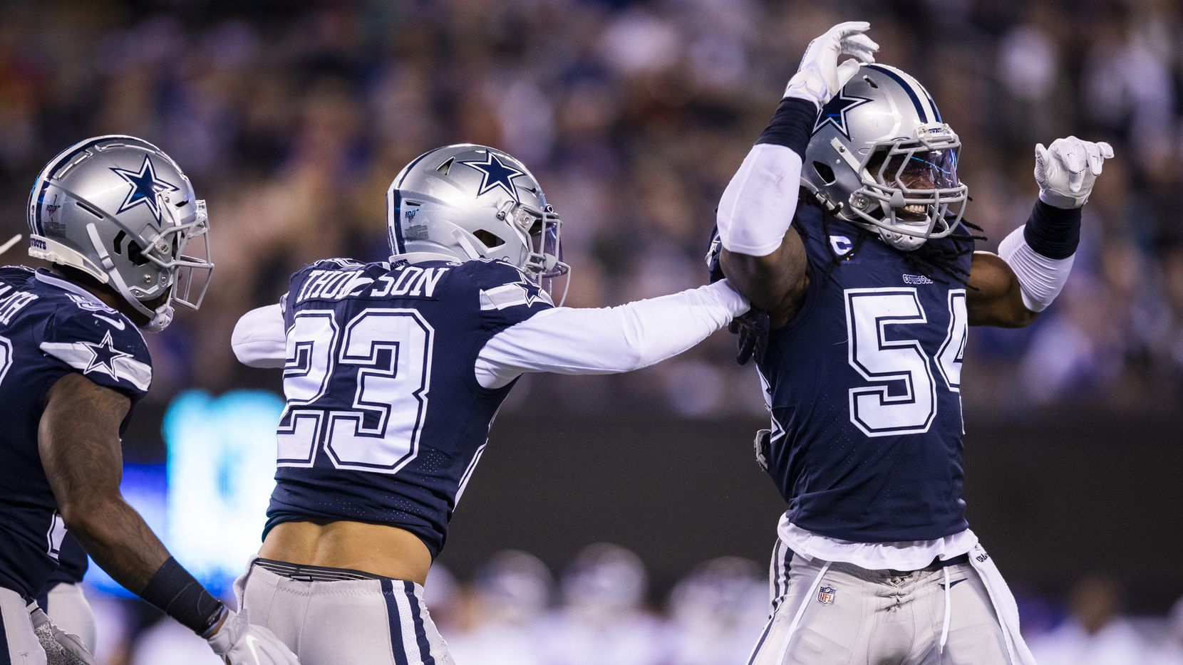 Dallas Cowboys middle linebacker Jaylon Smith (54) and defensive back Darian Thompson (23) celebrate a play during the second quarter of an NFL game between the Dallas Cowboys and the New York Giants on Monday, November 4, 2019 at MetLife Stadium in East Rutherford, New Jersey.