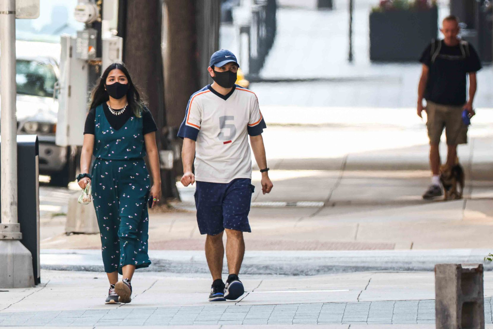 To mask or not to mask: Some pedestrians in downtown Dallas were taking extra precautions Wednesday while others were not.