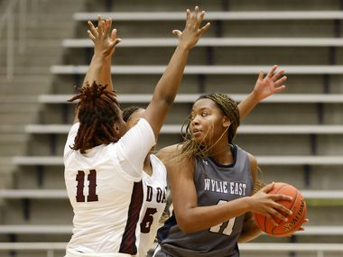 Red Oak's Markeya Mack (11) and Breanna Davis defend Wylie East's A'Kasha Davis (right) during Wylie East's 65-60 overtime win in a Class 5A Region II semifinal Friday.