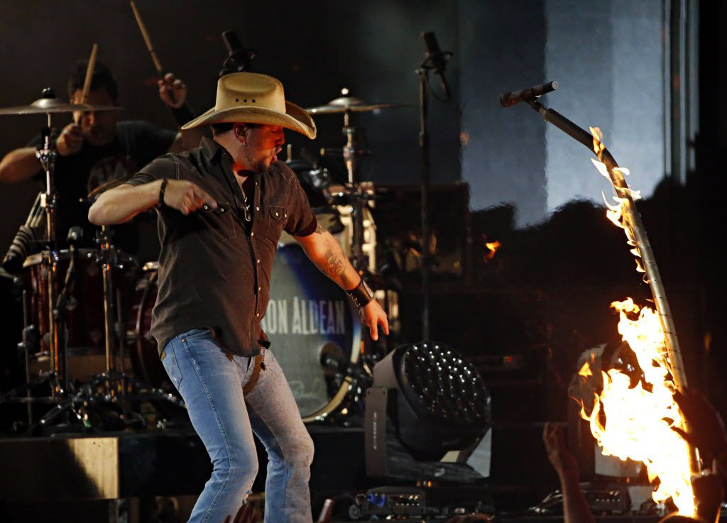 Jason Aldean sets his microphone stand on fire during the 2015 Academy of Country Music Awards Sunday, April 19, 2015 at AT&T Stadium in Arlington, Texas. (Andy Jacobsohn/The Dallas Morning News)