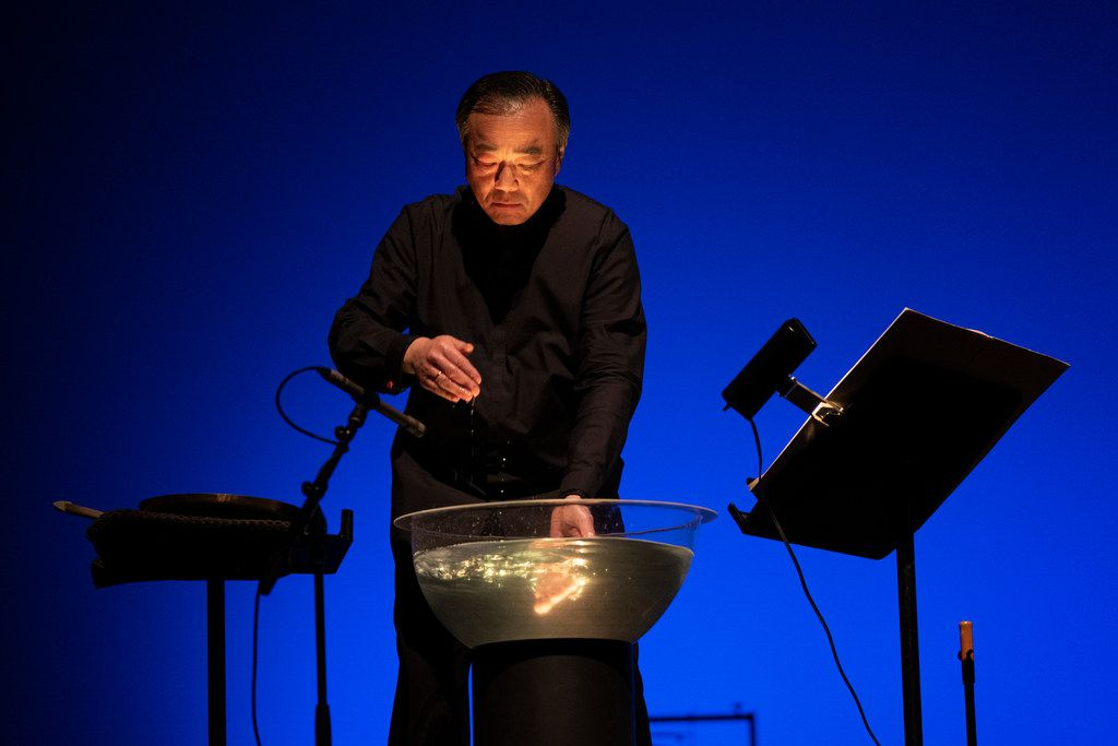 Violinist Cho-Liang Lin rustles water during a Chamber Music International performance of Tan Dun's Ghost Opera at the Charles W. Eisemann Center for Performing Arts in Richardson on Sept. 27, 2019.