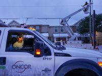 An Oncor crew works on along Elsie Faye Higgins Street as power outages continue across the state after a second winter storm brought more snow and continued freezing temperatures to North Texas on Wednesday, Feb. 17, 2021, in Dallas. (
