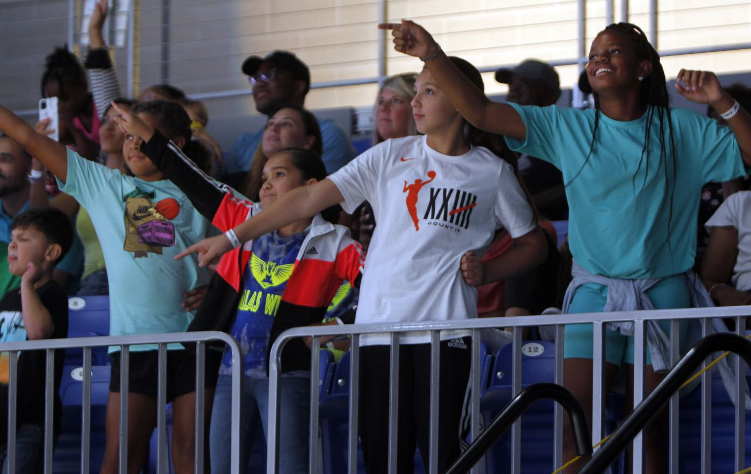 Young Wings fans display their dance moves for a chance to be seen on the scoreboard screen during a second half timeout of the Wings versus Chicago Sky game. The two WNBA teams played their game at College Park Center in Arlington on July 2, 2021. (Steve Hamm/ Special Contributor)