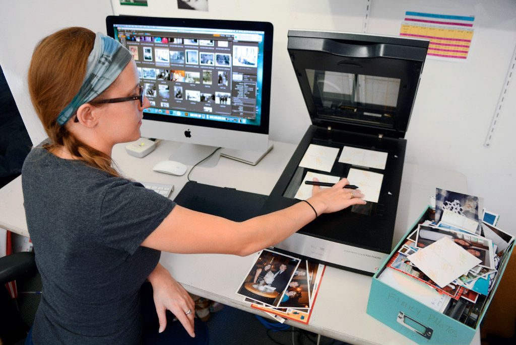 Imagining specialist Erin McClintic works in the lab at Phototronics in Winnetka, Ill., digitizing and archiving a shoebox of customer photographs, right.