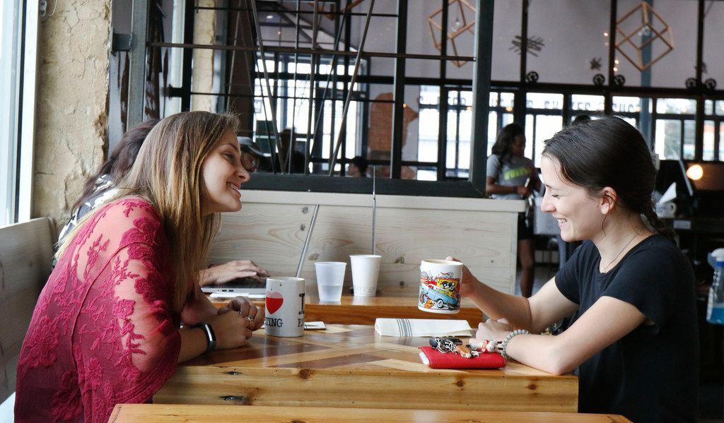 Jadee Hankins, left, and Tiffany Howig relax at Toasted Coffee + Kitchen in Dallas on Tuesday, September 26, 2017. (David Woo/The Dallas Morning News)