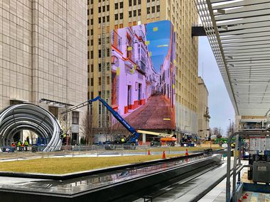 Work crews continue construction and test the 104-foot high video wall at AT&T's Discovery District.