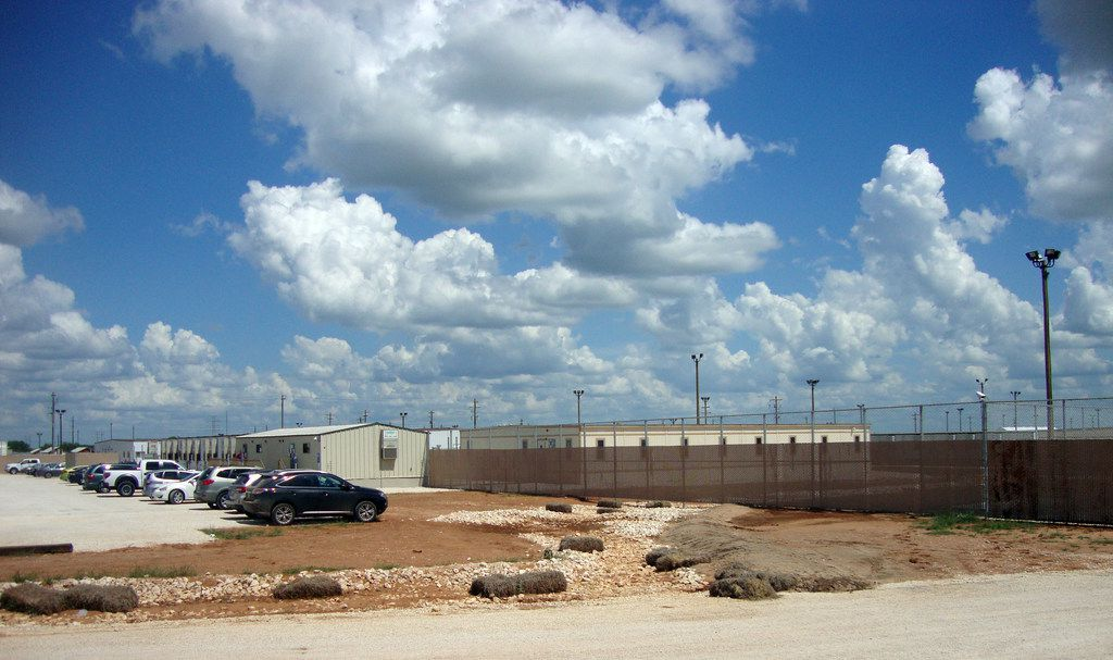 The South Texas Family Residential Center in Dilley, Texas, is the largest of the nation's three immigration detention centers for families, housing up to 2,400, and has drawn criticism from immigrants and advocates although the private company that operates it tries to make it less like a prison.
