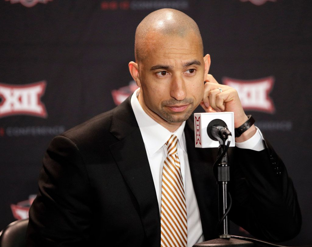 Texas coach Shaka Smart listens during the Big 12 Conference NCAA college basketball media day in Kansas City, Mo., Wednesday, Oct. 24, 2018. (AP Photo/Orlin Wagner)