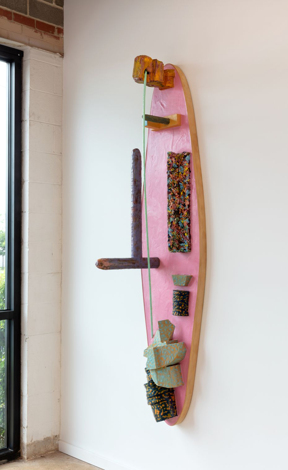 """John Miranda's 2019 piece """"Pink Surfer"""" is among the works he completed as a part-time artist. He previously worked in construction and as an elementary school teacher."""