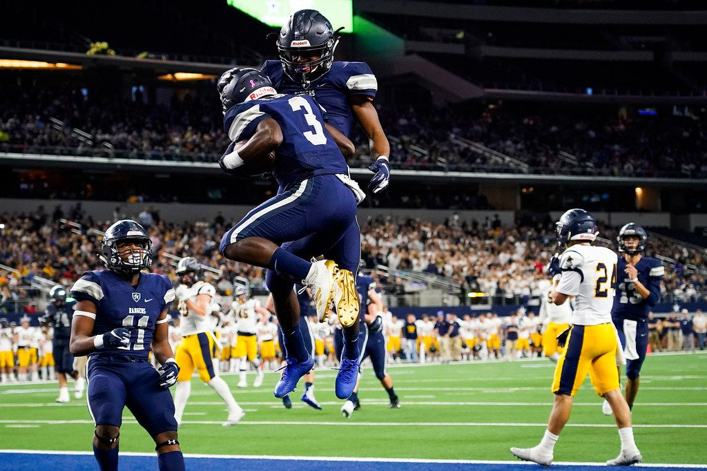 Frisco Lone Star wide receiver Tolu Sokoya (3) celebrates with running back Jaden Nixon after scoring on a 17-yard touchdown pass during the first half of a Class 5A Division I Region II semifinal playoff football game against Highland Park at AT&T Stadium non Friday, Nov. 29, 2019, in Arlington. (Smiley N. Pool/The Dallas Morning News)