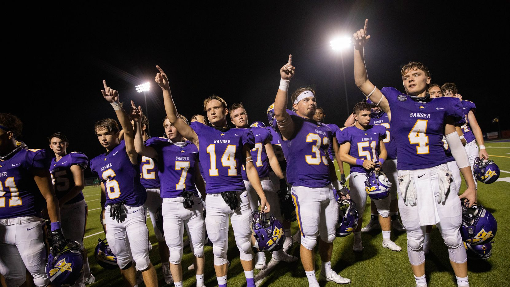 Sanger High School players celebrate after winning against Lake Worth High School on Sept. 4, 2020 in Sanger. Sanger won 49-35.