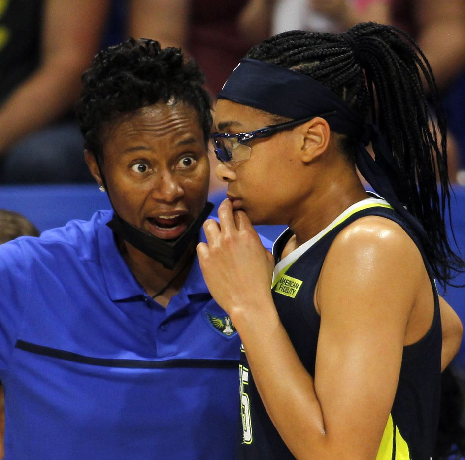 Dallas Wings head coach Vickie Johnson, left, shares some game strategy with Wings guard Allisha Gray (15) during a brief break of first half action against the Indiana Fever. The Dallas Wings hosted the Indiana Fever for their WNBA game held at College Park Center on the campus of UT-Arlington on August 20, 2021. (Steve Hamm/ Special Contributor)