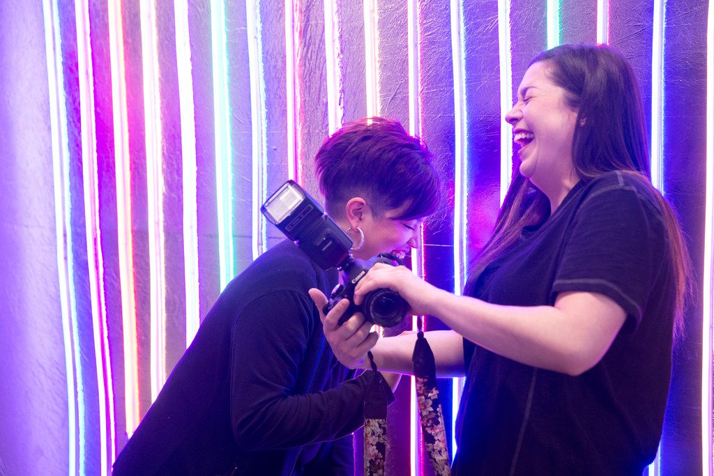 Jazmine Perdomo, left, of Arlington, Texas and Cortnie Bell of Mansfield, Texas laugh at a photo on the camera inside Snap 151, a pop-up installation, in Fort Worth, Texas on Thursday, January 17, 2019. The pop-up runs from 10 a.m.-10 p.m. until January 27. (Daniel Carde/The Dallas Morning News)