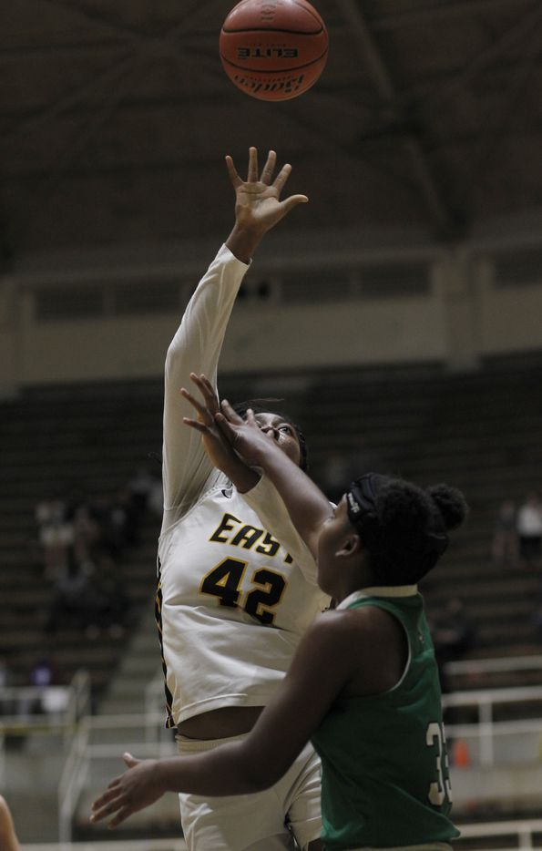 Plano East forward Idara Udo (42) puts up a shot as Southlake Carroll forward Jordan Sowell (33) defends during first half action. Plano East won 56-42 to advance. The two teams played their Class 6A regional semifinal girls playoff basketball game at Loos Field House in Addison on February 27, 2021. (Steve Hamm/ Special Contributor)