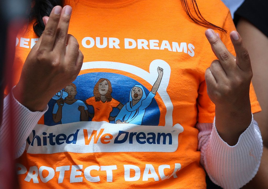 United We Dream youths and allies snap their fingers to show support to other DACA recipients speaking to the media after a court hearing Aug. 8, 2018, at the U.S. District Courthouse in Houston in a lawsuit filed by states challenging DACA program.