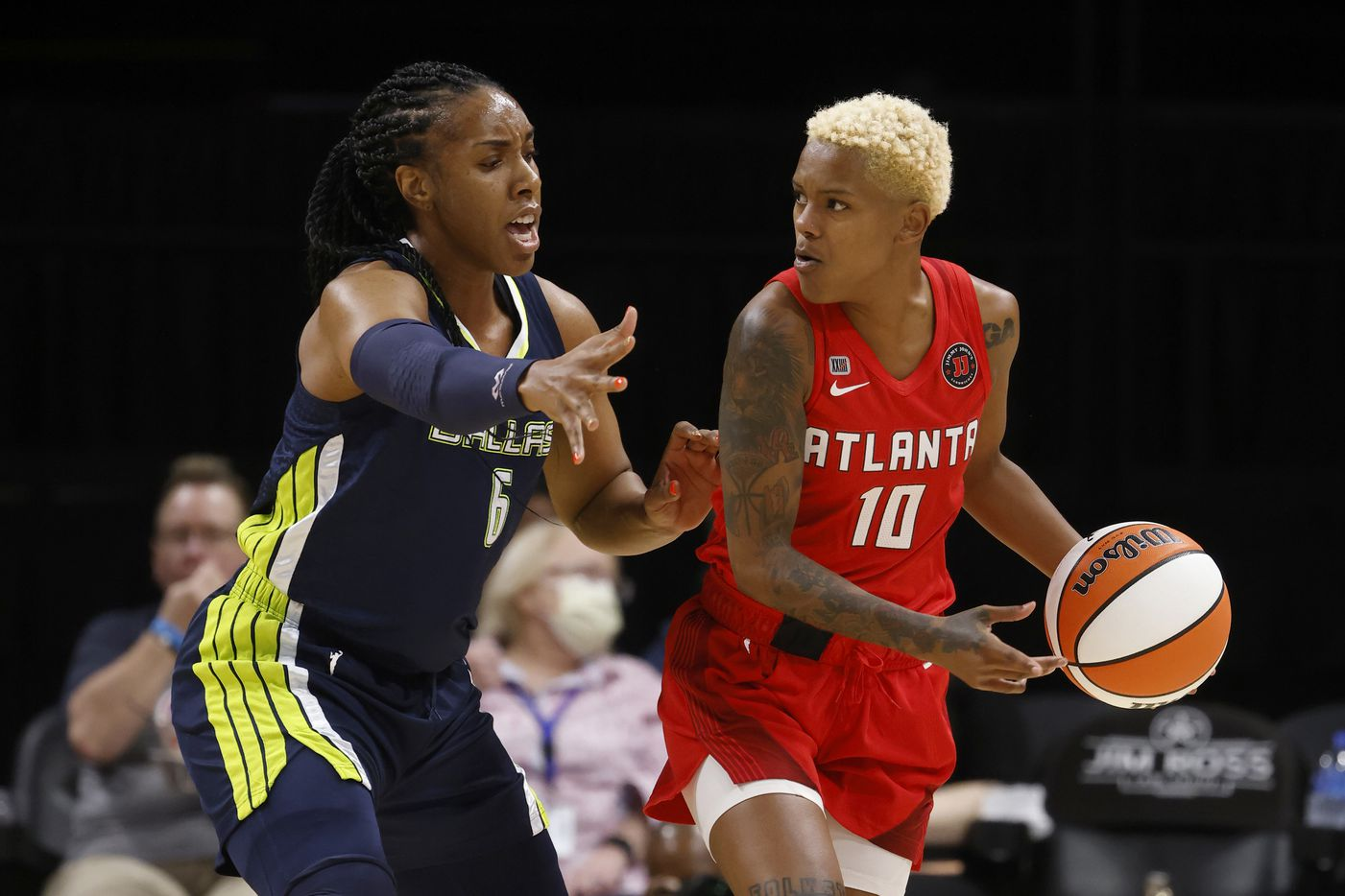 Dallas Wings forward Kayla Thornton (6) defends Atlanta Dream guard Courtney Williams (10) during the first half of their WNBA basketball game in Arlington, Texas on Sept. 2, 2021. (Michael Ainsworth/Special Contributor)