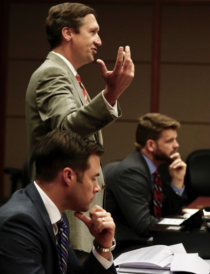 Tomi Lahren's attorneys Chris Simmons, left, and Brian Lauten, center, and representing The Blaze and Glenn Beck, Eli Burriss, right, during a hearing in Dallas County Civil District Court on Monday, April 24, 2017 for a judge to consider her attorneys' motion to hold her onetime employer Glenn Beck and The Blaze in contempt of court. (David Woo/The Dallas Morning News)