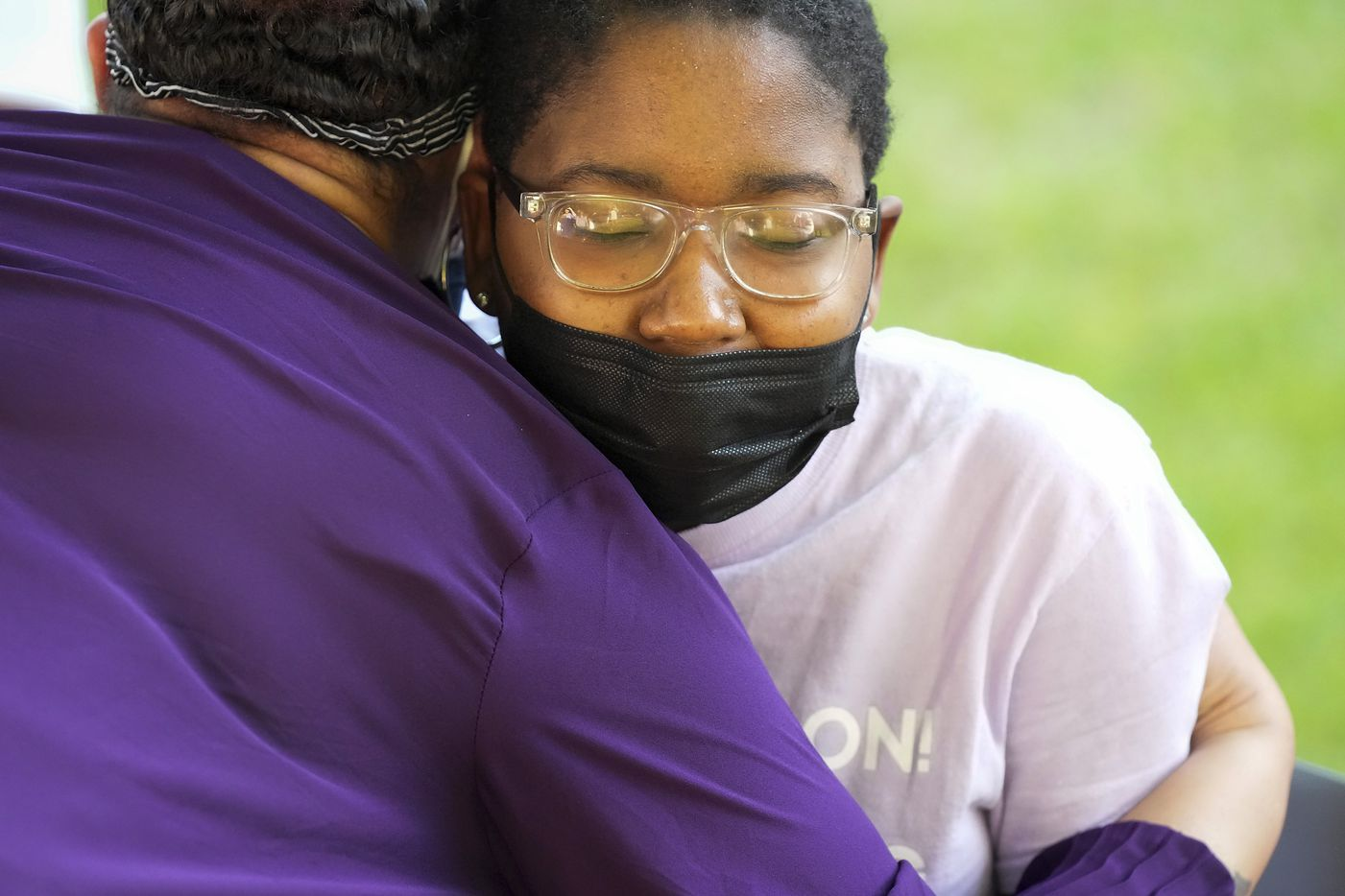 Eryn Fayson gets a hug from a well wisher in her front yard after her graduation from Booker T. Washington HSPVA on Saturday, June 19, 2021.