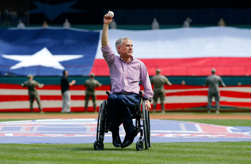Texas Gov. Greg Abbott, shown as he threw the ceremonial first pitch  on the Texas Rangers' opening day at Globe Life Park in Arlington in March, has used aggressive fundraising throughout his political career to discourage opposition as he moved up the state's political ladder.