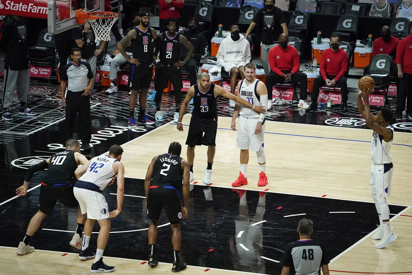Dallas Mavericks guard Josh Richardson (0) shoots a free throw during the second half of an NBA playoff basketball game against the LA Clippers at Staples Center on Wednesday, May 26, 2021, in Los Angeles. The Mavericks won the game 127-121.