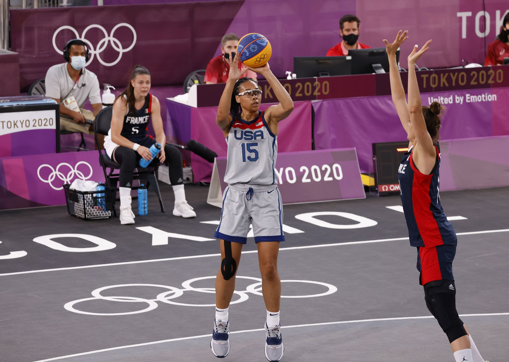 USA's Allisha Gray (15) shoots in front of France's Ana Maria Filip (11) in a 3x3 women's basketball game during the postponed 2020 Tokyo Olympics at Aomi Urban Sports Park on Saturday, July 24, 2021, in Tokyo, Japan. USA defeated France 17-10 in the game. (Vernon Bryant/The Dallas Morning News)