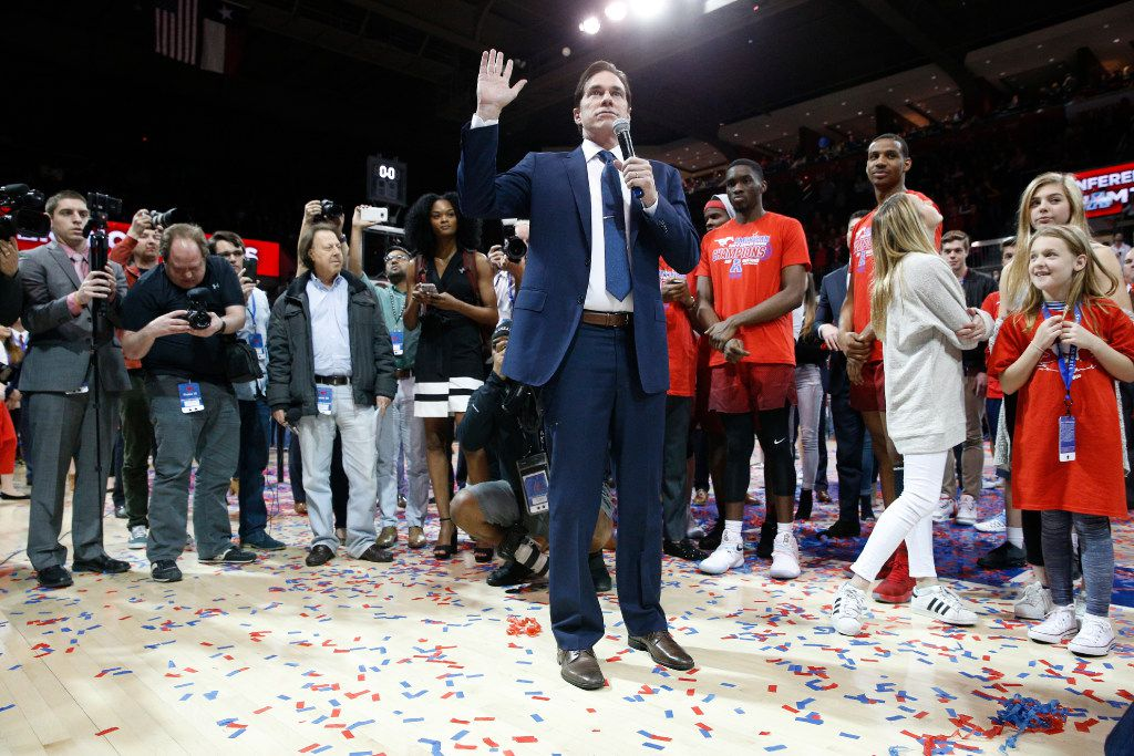 Southern Methodist Mustangs head coach Tim Jankovich celebrates his team winning the American Athletic Conference regular season conference title at Moody Coliseum in Dallas on March 4, 2017 by beating Memphis by a score of 103-62. (Nathan Hunsinger/The Dallas Morning News)