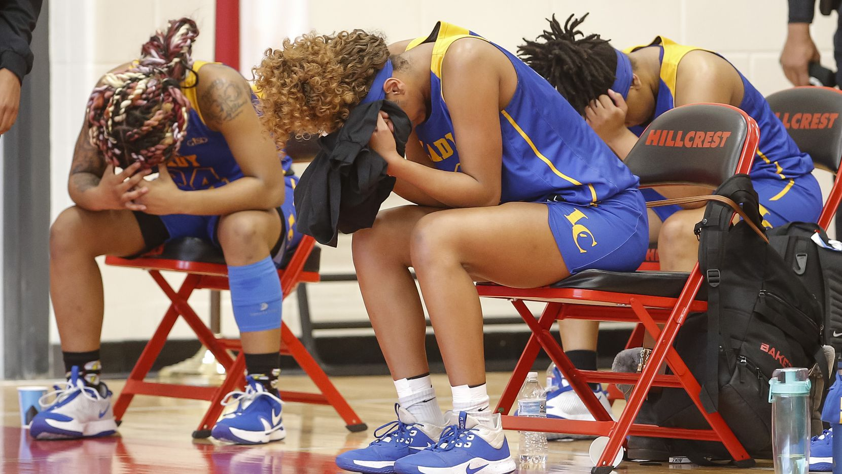 Members of the Lakeview Centennial girls basketball team react after falling 49-42 to Skyline in the first-round playoff game at Hillcrest High School in Dallas, Saturday, February 13, 2021. (Brandon Wade/Special Contributor)