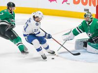 Dallas Stars goaltender Ben Bishop (30) blocks a shot by Tampa Bay Lightning center Brayden Point (21) during the first period of a NHL matchup between the Dallas Stars and the Tampa Bay Lightning on Monday, Jan. 27, 2020, at American Airlines Center in Dallas.
