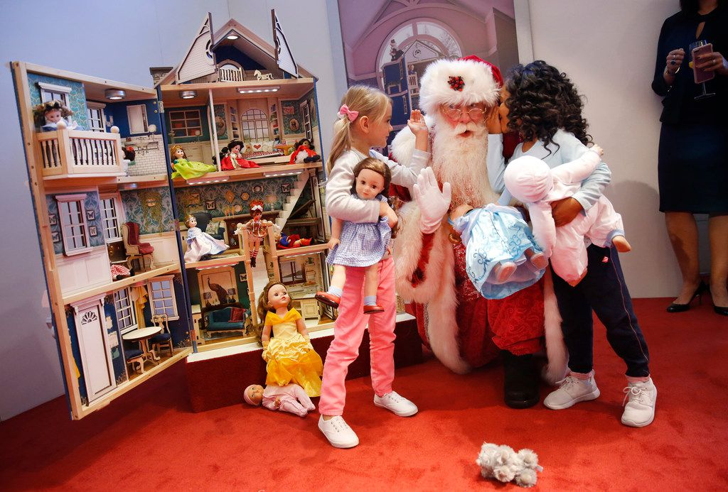 Santa Claus here's a wish list from child models Olivia (left) and Payton (right) as they pose before a limited-edition dollhouse by KidKraft that was featured at Neiman Marcus' Christmas Book Fantasy Gift Reveal at the Park Place Premier Collection in Dallas, Tuesday, October 17, 2017. (Tom Fox/The Dallas Morning News)
