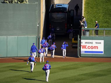 Texas Rangers players head to the team bus after a 4-3 loss to the Colorado Rockies in a spring training game at Salt River Fields at Talking Stick on Wednesday, Feb. 26, 2020, in Scottsdale, Ariz.