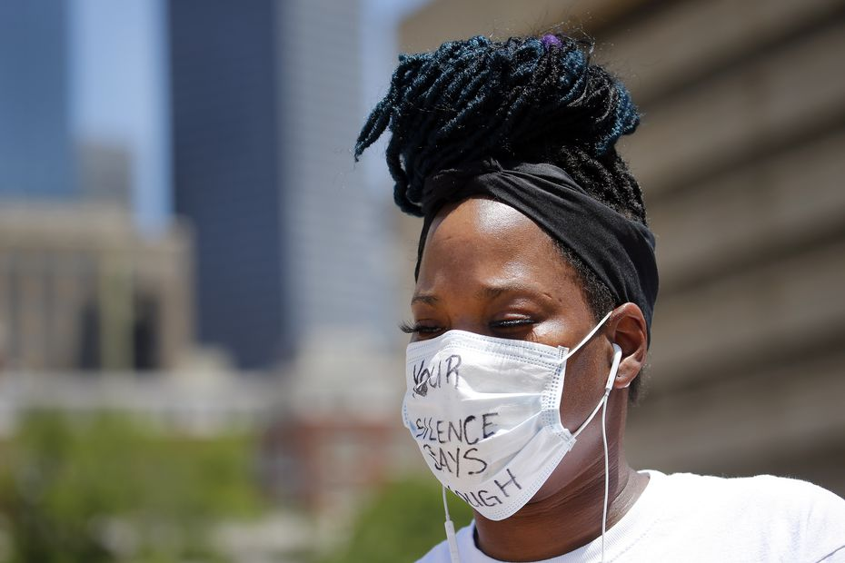 """Adrienne Peoples of Plano wore a protective mask with the phrase """"Your Silence Says Enough."""""""