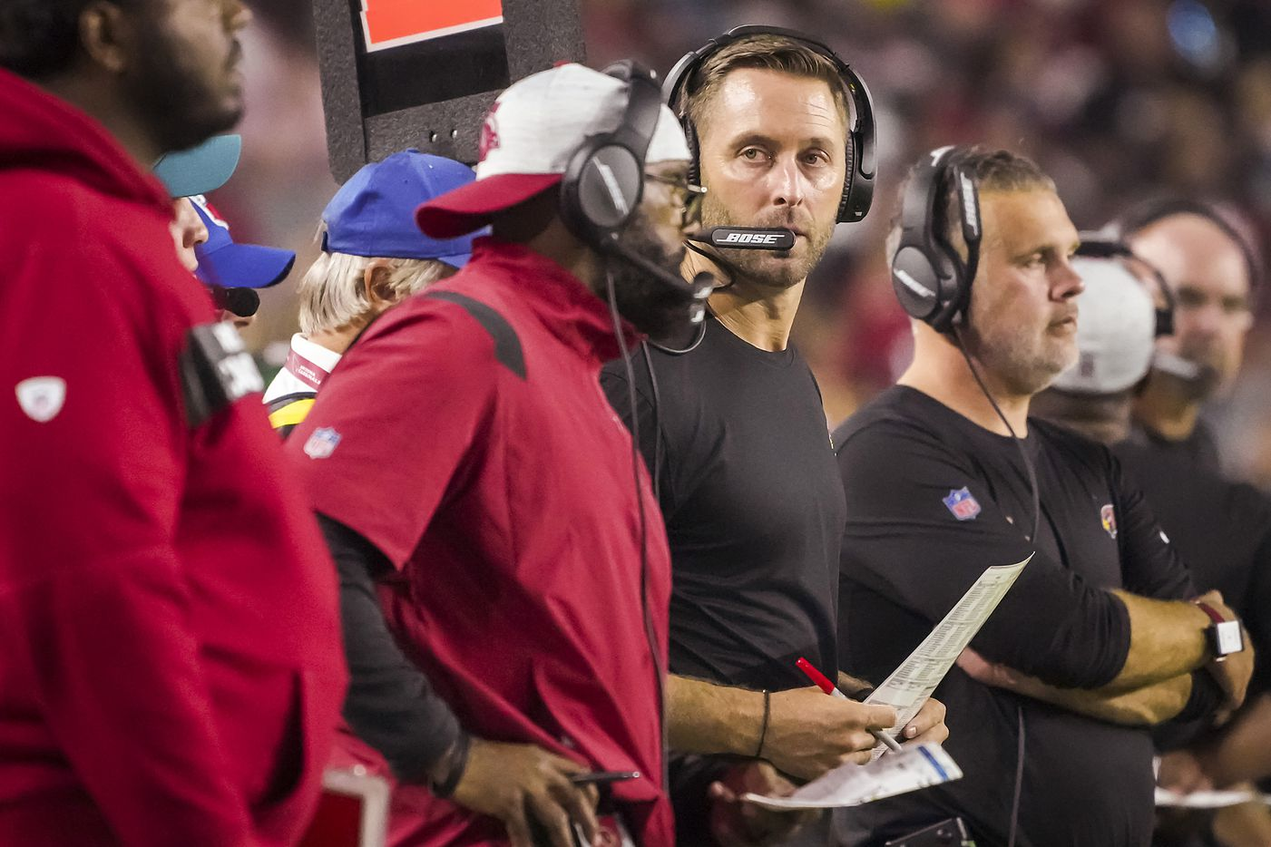 Arizona Cardinals head coach Kliff Kingsbury watches from the sidelines during the second quarter of an NFL football game against the Dallas Cowboys at State Farm Stadium on Friday, Aug. 13, 2021, in Glendale, Ariz.