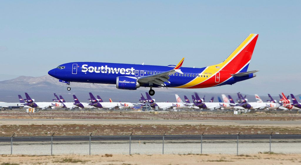 In this March 23, 2019, file photo, a Southwest Airlines Boeing 737 Max aircraft lands at the Southern California Logistics Airport in the high desert town of Victorville, Calif. Southwest Airlines Co. reports earns on Thursday, April 25.