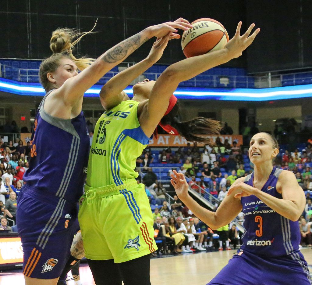 Phoenix Mercury center Cayla George (23) blocks shot by Dallas Wings guard Allisha Gray (15) in overtime of Phoenix's 101-100 overtime win during the Dallas Wings vs. Phoenix Mercury WNBA basketball game at the UTA College Park Center in Arlington, Texas on Thursday, August 10, 2017. (Louis DeLuca/The Dallas Morning News)