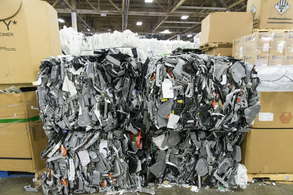 Bales of plastic stacked up in the Texas Recycling plant on July 27 in Dallas. (Ting Shen/The Dallas Morning News)