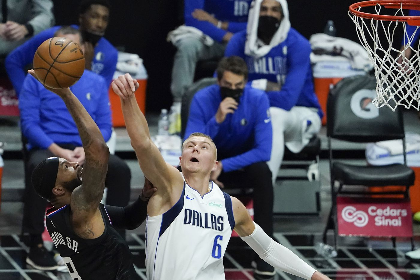 Dallas Mavericks center Kristaps Porzingis (6) blocks a shot by LA Clippers forward Marcus Morris Sr. (8) during the second half of an NBA playoff basketball game at Staples Center on Tuesday, May 25, 2021, in Los Angeles.