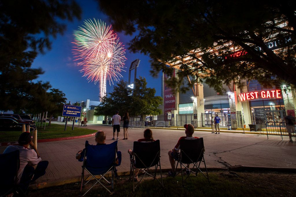 Fans relax in the parking lot and watch fireworks explode over Toyota Stadium after a 3-2 win by FC Dallas over the Atlanta United on Wednesday, July 4, 2018, in Frisco, Texas. (Smiley N. Pool/The Dallas Morning News)