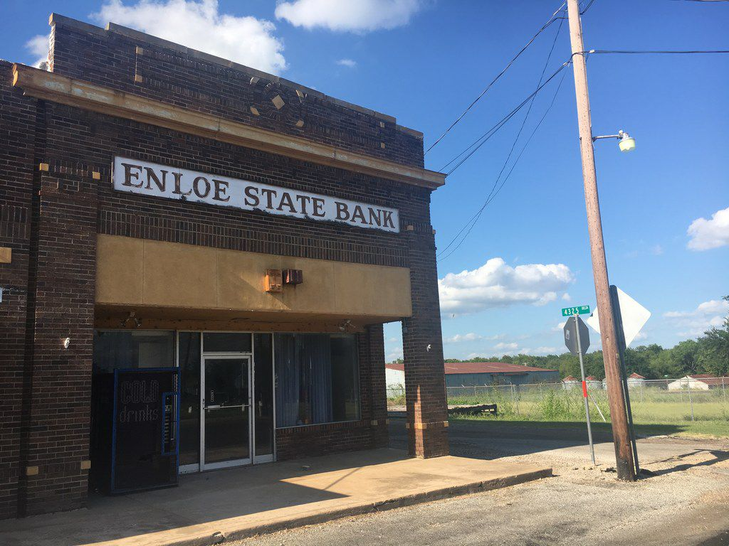 The building that once housed the Enloe State Bank. Today, the empty building sits on the corner of a stretch of empty storefronts.