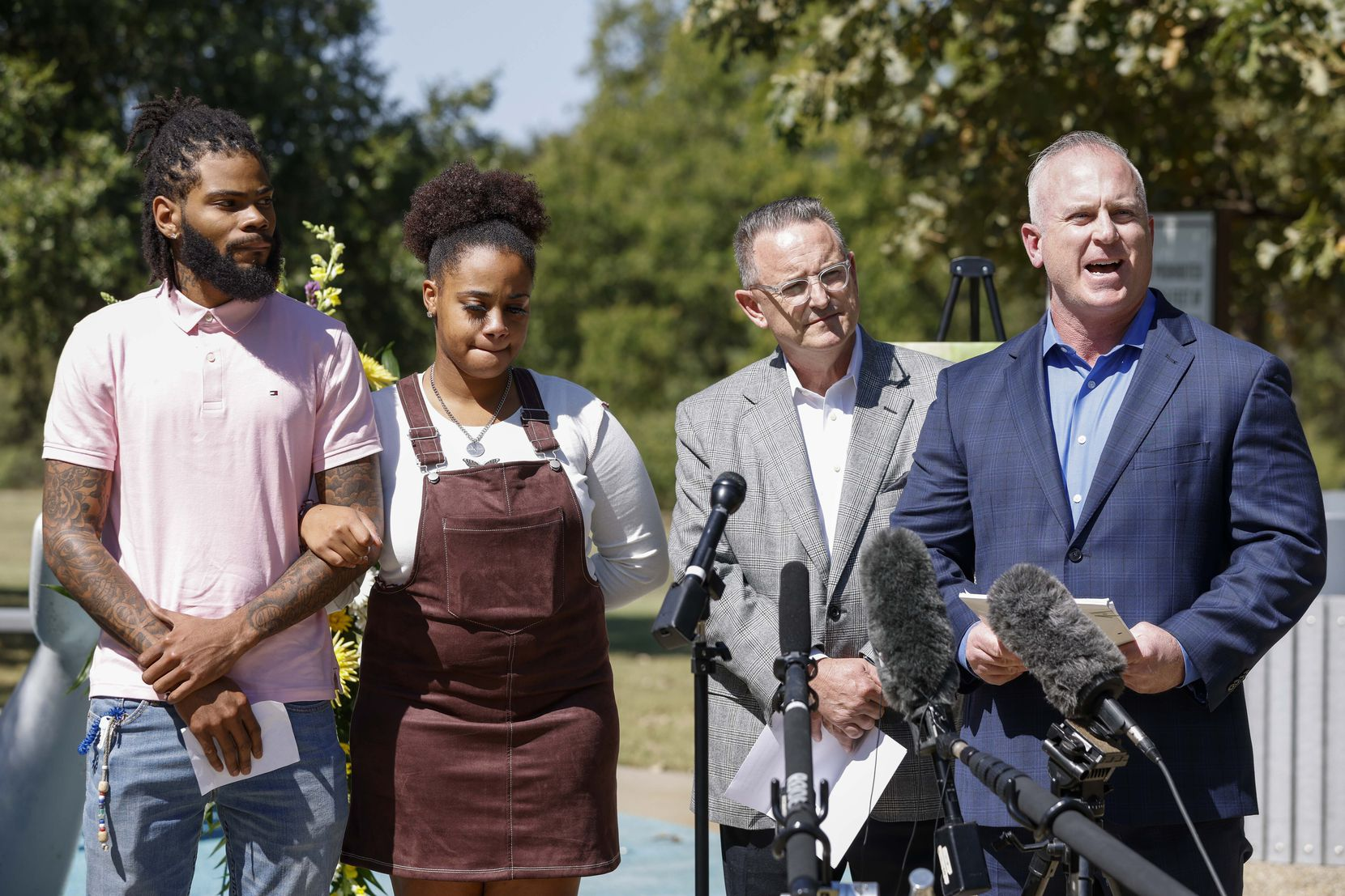 Attorney Brian Hargrove (right) speaks alongside Tariq Williams (left) and Kayla Mitchell during a press conference at Don Misenhimer Park on Monday in Arlington. Williams and Mitchell are the parents of 3-year-old Bakari Williams who died Sept. 11 after contracting a brain-eating amoeba the splash pad at the park.