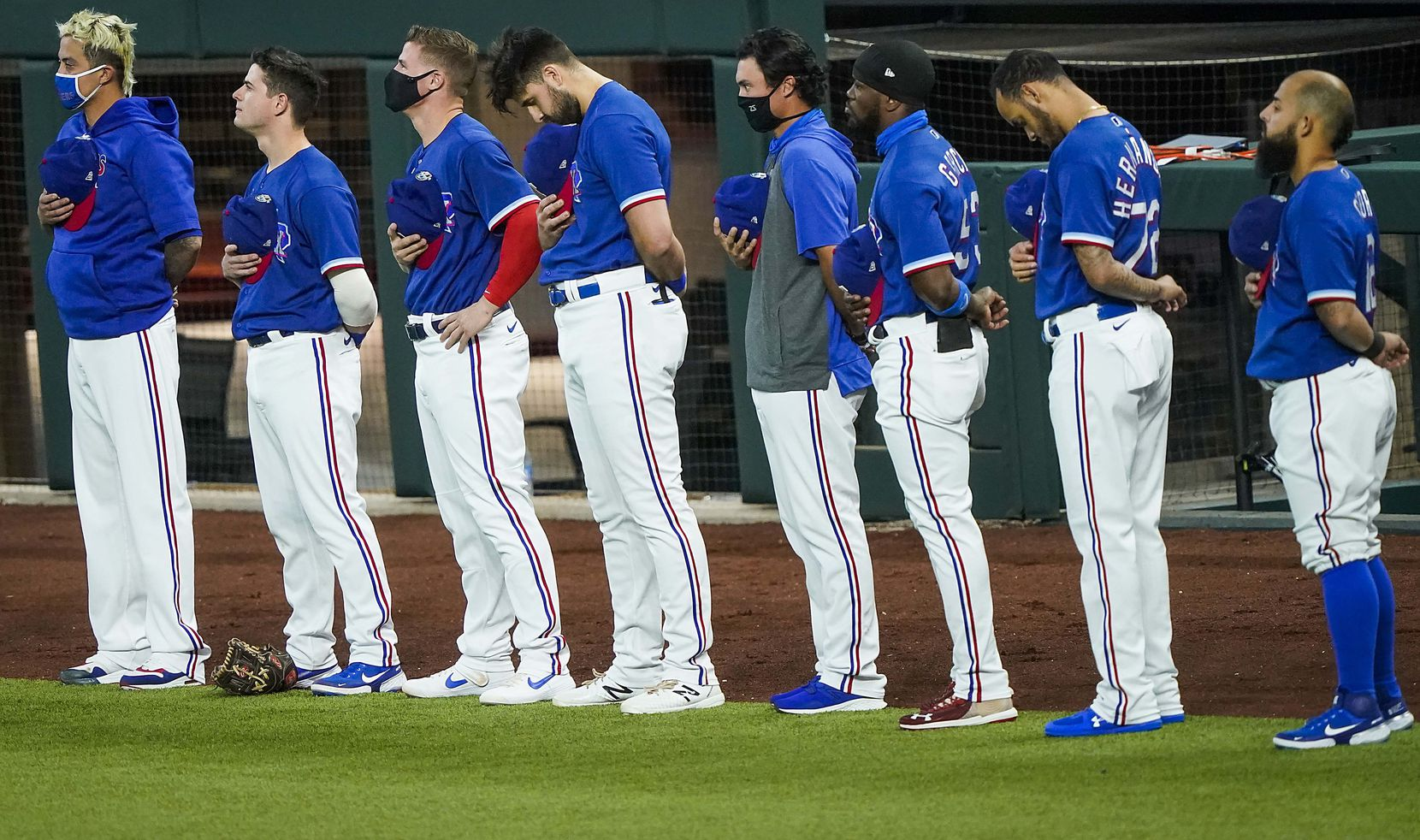 Texas Rangers players stand for the national anthem before exhibition game against the Colorado Rockies at Globe Life Field on Tuesday, July 21, 2020