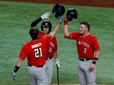Texas Tech freshman infielder Nate Rombach (21) is greeted at home plate by teammates Max Marusak (20) and Jace Jung (2) after his home run broke a scoreless tie in the top of the 2nd inning of their game against Ole Miss.