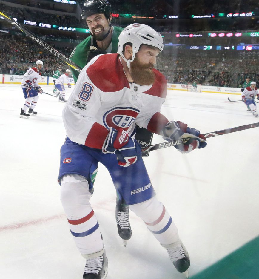 Montreal Canadiens defenseman Jordie Benn (8) is hit by Dallas Stars left wing Jamie Benn (14) during the first period of an NHL hockey game in Dallas, Tuesday, Nov. 21, 2017. (AP Photo/LM Otero)
