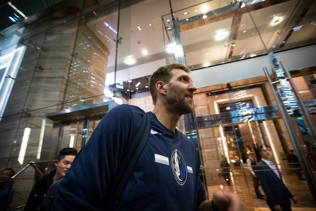 Dallas Mavericks forward Dirk Nowitzki heads into the entrance as the team arrives at their hotel on Tuesday, Oct. 2, 2018, in Shanghai. The Dallas Mavericks will face the Philadelphia 76ers in Shanghai on Oct. 5th in the first of two NBA China Games 2018 preseason basketball games. (Smiley N. Pool/The Dallas Morning News)