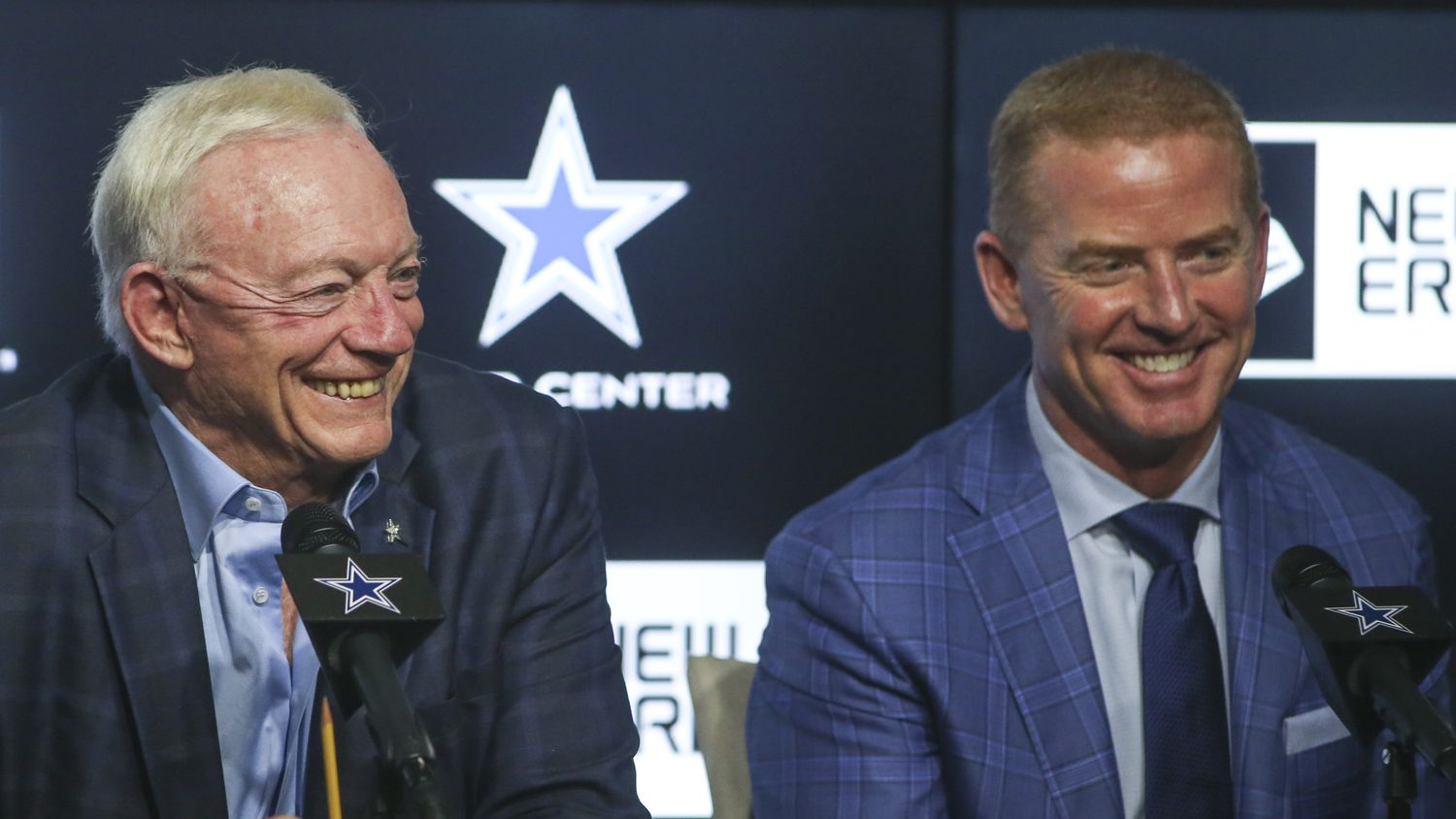 Dallas Cowboys owner Jerry Jones, left, and head coach Jason Garrett laugh at a joke by executive vice president Stephen Jones, not pictured, while speaking to reporters after the second night of the NFL Draft on Friday, April 26, 2019 at The Star in Frisco, Texas.