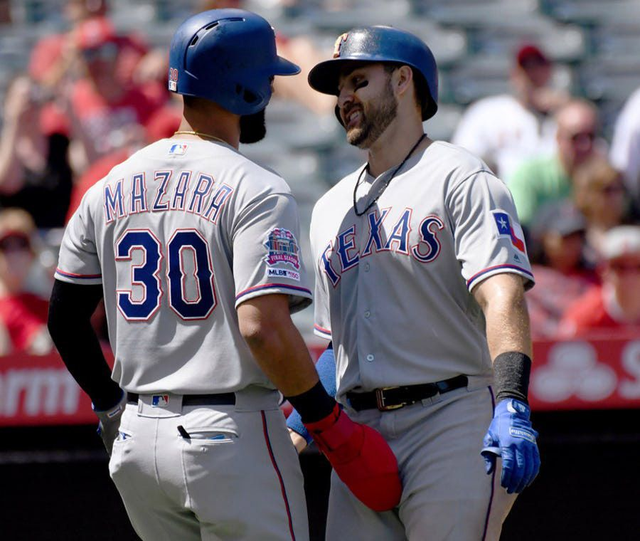 Texas Rangers' Joey Gallo, right, is greeted at home plate by Nomar Mazara after hitting a two-run home run against the Los Angeles Angels during the second inning of a baseball game Sunday, April 7, 2019, in Anaheim, Calif. (AP Photo/Michael Owen Baker)