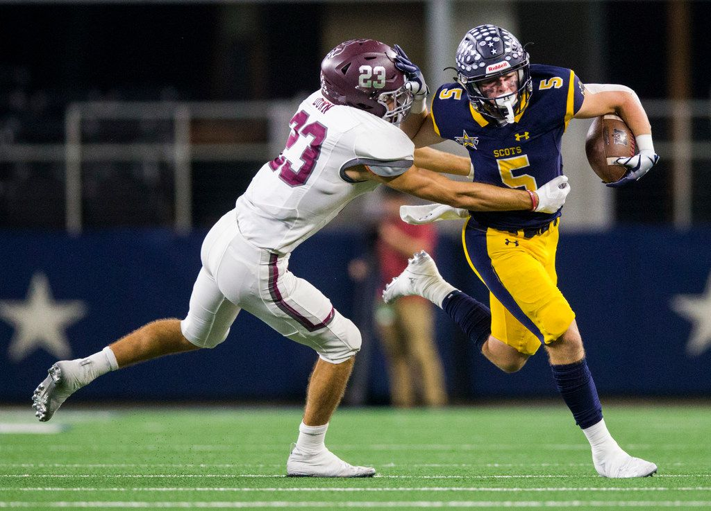 Highland Park receiver Case Savage (5) pushes away Magnolia defensive back Blaine Dunn (23) during the third quarter of a Class 5A Division I area-round playoff game between Magnolia and Highland Park on Thursday, November 21, 2019 at AT&T Stadium in Arlington. (Ashley Landis/The Dallas Morning News)