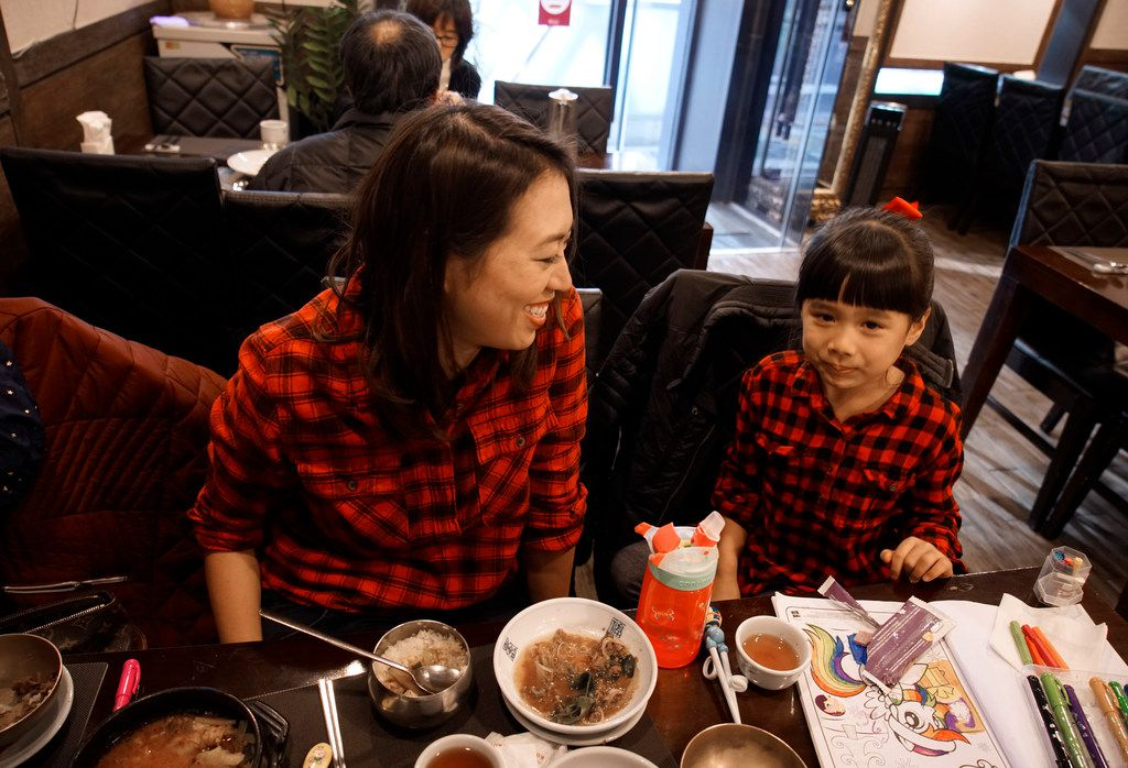 Elise Hu, NPR reporter, eats dinner with her daughter, Eva, 5.